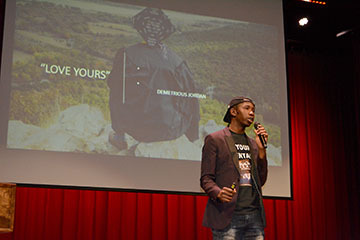 A photo of Demetrious Jordan speaking at the student symposium